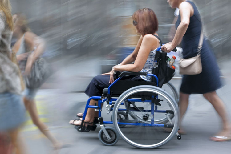 Woman being pushed in wheelchair
