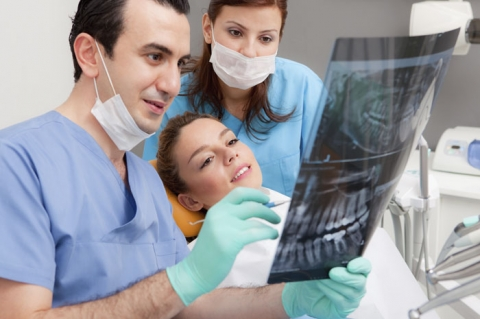 Dentist going over x-rays with patient