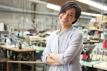 Woman smiling in a sewing factory